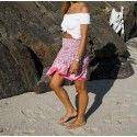 Mini falda asimétrica rosa de seda preciosa